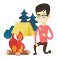 young man roasting marshmallow over campfire vector image vector image