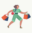 woman walks with gift bags vector image vector image