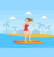 Female surfer riding surfboard at tropical resort