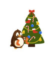 penguin with knitted socks near christmas tree vector image