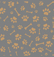 seamless pattern of paws and bones vector image