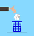 throw garbage in the basket vector image