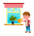 boy child watering house plant with can vector image vector image
