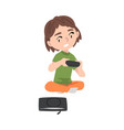 excited girl sitting on floor with joystick kid vector image vector image