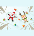santa claus and reindeer make a snow angel vector image