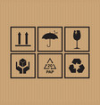 packaging symbols set on cardboard background vector image