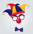 jester hat with clown glasses and red nose vector image