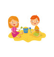 two little kids boy and girl playing in sandbox vector image