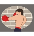 Young boxer in blue shorts trained against a brick vector image vector image