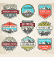 mountain grunge color insignias vector image vector image