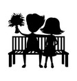 romantic couple sitting on a bench