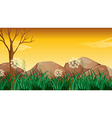 Big rocks near the tree without leaves vector image vector image
