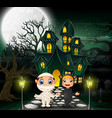 happy halloween in front of the haunted house with vector image vector image