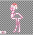 Neon flamingo in santa christmas hat on