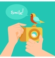 digital camera and cartoon bird vector image