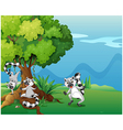 Playful lemurs playing near the big tree vector image vector image