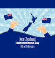 hand holds a new zealand flag independence day vector image