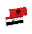 flags albania and iraq on a white background
