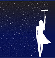 woman painting stars on wall with a painting vector image vector image