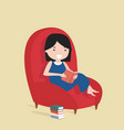 small girl reading the book sitting on a sofa vector image