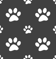 paw icon sign Seamless pattern on a gray vector image vector image