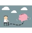 Businessman putting money to a piggy bank vector image