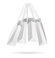 Hanging white paper bags vector image vector image