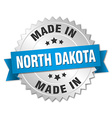 made in North Dakota silver badge with blue ribbon vector image vector image