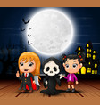 happy halloween kids with scary house and full moo vector image vector image