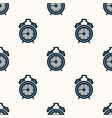 seamless pattern of alarm clocks on the vector image