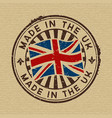 made in uk stamp on wooden background vector image