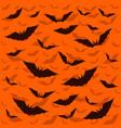 bat dark on orange background vector image vector image