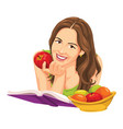 woman holding apple and reading a book vector image