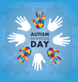 autism awareness concept with hand of puzzle vector image vector image