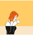 a red-haired girl sniffing coffee cup by the face vector image