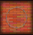 barbed wire circle on red brick background vector image vector image