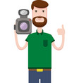 image of man with beard holds video camera vector image vector image