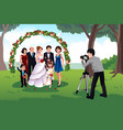 man photographing a family in a wedding vector image vector image