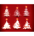 christmas trees on red vector image vector image