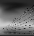 barbed wire fence on blurred grey background vector image vector image