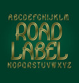 road label typeface golden font isolated english vector image vector image