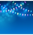 Blue Christmas background with lights vector image vector image