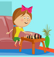 little girl playing chess sitting on sofa in room vector image vector image