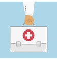 First aid kit in hands doctor vector image vector image