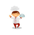 smiling boy holding dish in hand cute kid in chef vector image