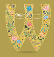yellow letter w with floral decor and necklace vector image vector image