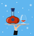 bottle of cognac and glass on tray on blue vector image vector image