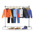 clothes hanger with casual man clothes footwear vector image
