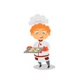 cute red-haired boy holding tray with fresh-baked vector image vector image