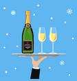 bottle of champagne and glass on tray on blue vector image vector image